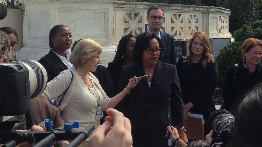NAACP Legal Defense Fund Litigation Director Christina Swarns, lead counsel for Duane Buck, speaks to the media outside the U.S. Supreme Court following the argument in Buck v. Davis on October 5, 2016. Next to Ms. Swarns is National Public Radio Supreme Court reporter Nina Totenberg. (DPIC photo by Robert Dunham.)