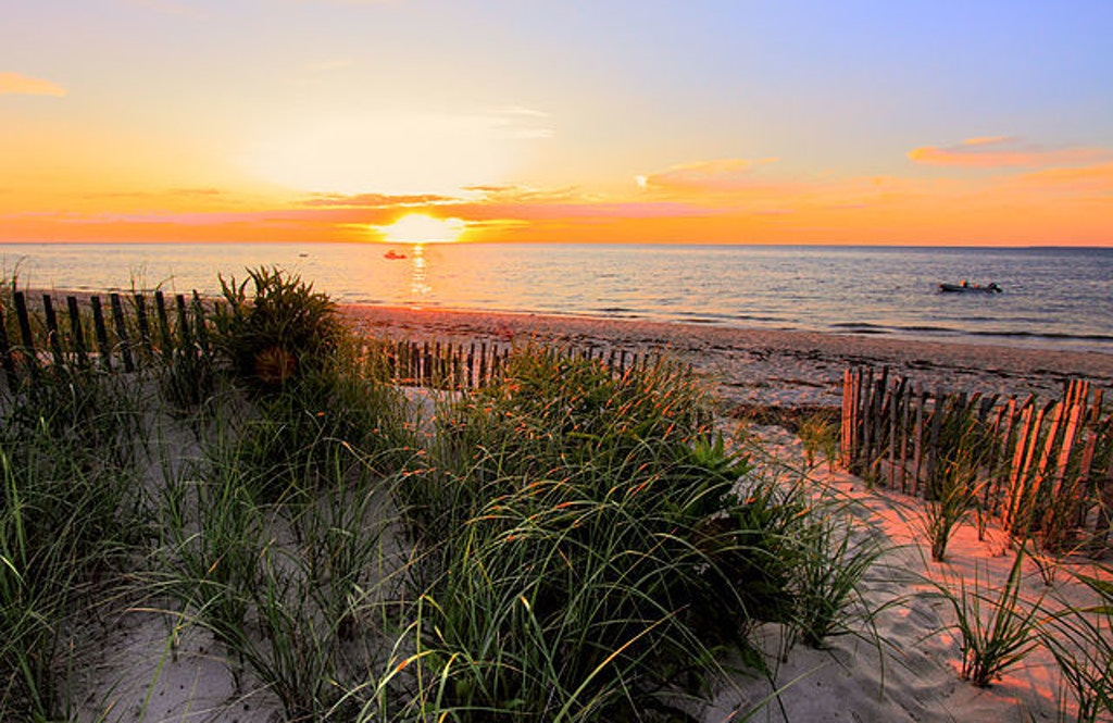 Sunset on Cape Cod Bay.  Photo by PapaDunes via flickr.